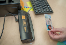 photo of raptor check-in device and drivers license being scanned